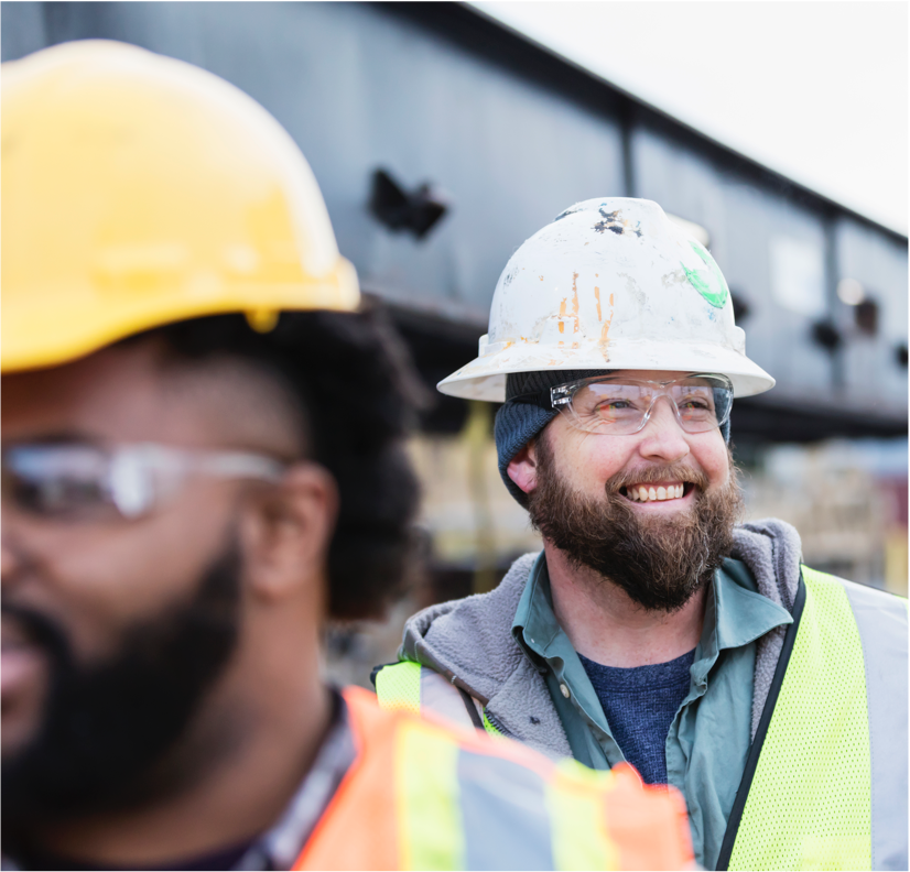 Construction worker in hardhat smiling
